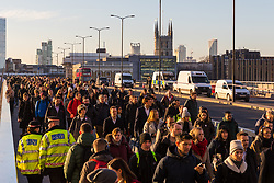 © Licensed to London News Pictures. 02/12/2019. London, UK. Police officers amongst commuters as they walk to work on London Bridge. Two victims were died following a terrorist attack near London Bridge on 29th November when police shot dead the attacker. Photo credit: Vickie Flores/LNP