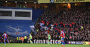 The Holmesdale fanatics celebrate their ten years of support  during the Barclays Premier League match between Crystal Palace and Southampton at Selhurst Park, London, England on 12 December 2015. Photo by Michael Hulf.