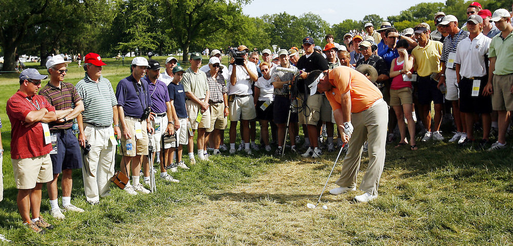 Kenneth Ferrie of England hits from the rough along the edge of the gallery on the fourteenth hole during the second day of the US Open Golf Championship at Winged Foot Golf Club in Mamaroneck, New York Friday, 16 June 2006.
