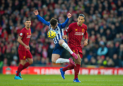 LIVERPOOL, ENGLAND - Saturday, November 30, 2019: Liverpool's Virgil van Dijk (R) challenges Brighton & Hove Albion's Aaron Connolly during the FA Premier League match between Liverpool FC and Brighton & Hove Albion FC at Anfield. (Pic by David Rawcliffe/Propaganda)