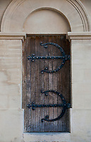 Detail of an old wooden door with wrought iron at Avignon, France.