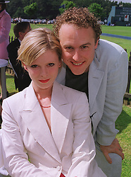 Actress EMILIA FOX and MR SAM WEST, at a polo match in Berkshire on 13th June 1999.MTD 130