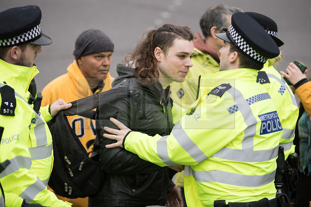 """© Licensed to London News Pictures. 11/03/2018. London, UK. A man is removed from the demonstration by police . Alt right group Generation Identity and other far-right groups hold a demonstration at Speakers' Corner in Hyde Park , opposed by antifascists . Generation Identity supporters Martin Sellner and Brittany Pettibone were due to speak at the demo but were arrested and detained by police when they arrived in the UK , also forcing them to cancel an appearance at a UKIP """" Young Independence """" youth event , which in turn was reportedly cancelled amid security concerns . Photo credit: Joel Goodman/LNP"""
