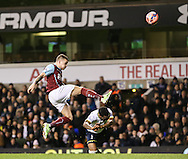 Danny Rose of Tottenham Hotspur (right) is beaten to the ball by Kieran Trippier of Burnley (left) during the FA Cup match at White Hart Lane, London<br /> Picture by David Horn/Focus Images Ltd +44 7545 970036<br /> 14/01/2015