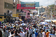 Crowds walk down the street as they follow the parade held on the occasion of the annual Oguaa Fetu Afahye Festival in Cape Coast, Ghana on Saturday September 6, 2008..