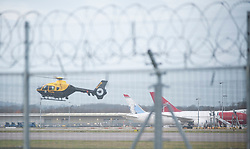 © Licensed to London News Pictures. 20/12/2018. Gatwick, UK. Police helicopter, view from airport Perimeter, Drone has closed Gatwick airport with all flights in and out cancelled while police hunt for drone pilot deliberately targeting airport.Photo credit: Grant Falvey/LNP