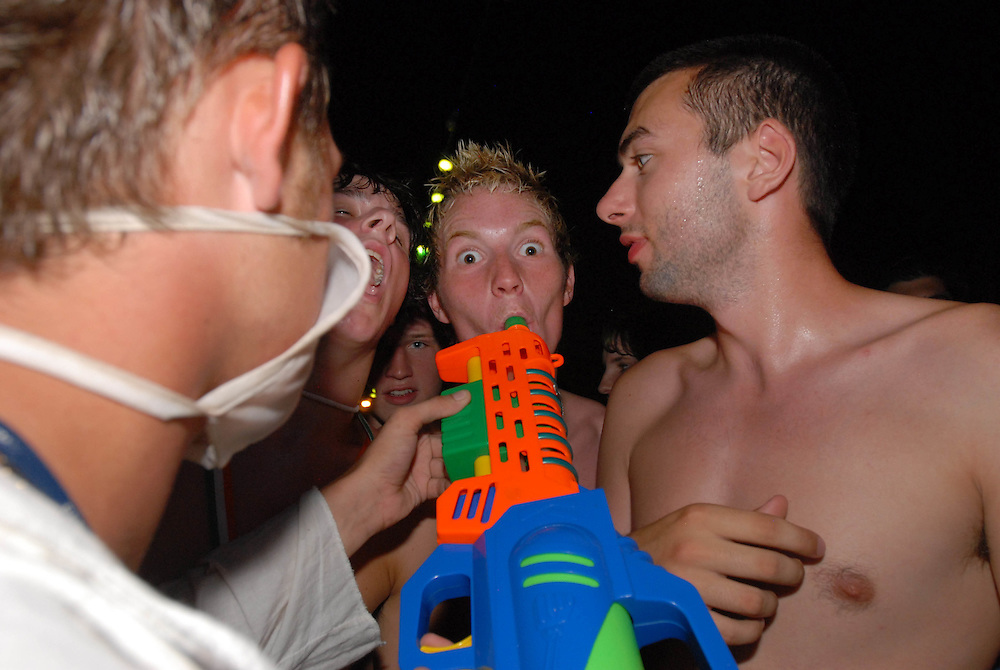 Teenager takes a shot from one of 10 tequila guns on board the fantasy boat party, which contain a mixture of tequila, vodka, blue curacao, wine, ouzo and mixed fruit juices on board the Napa Queen in Ayia Napa, Cyprus. .