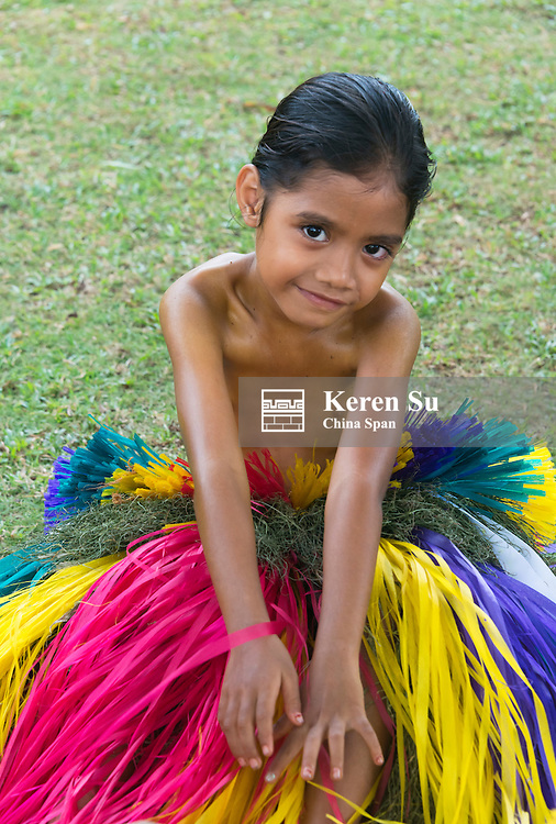 Yapese girl wearing grass skirt at Yap Day Festival, Yap Island, Federated States of Micronesia