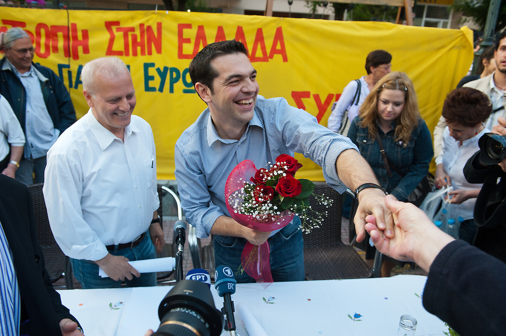 Alexis Tsipras cheering the crowd prior to his speech in the open Assembly of SYRIZA in Aghia Ekaterini Square, in the Kato Petralona neighbourhood  of Athens.