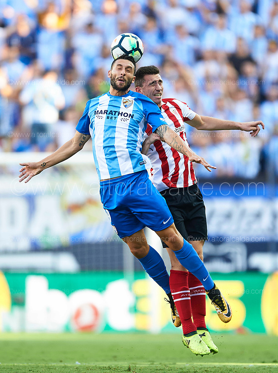 MALAGA, SPAIN - SEPTEMBER 23:  Borja Gonzalez of Malaga CF (L) competes for the ball with Aymeric Laporte  of Athletic Club (R) during the La Liga match between Malaga and Athletic Club at Estadio La Rosaleda on September 23, 2017 in Malaga, .  (Photo by Aitor Alcalde Colomer/Getty Images)