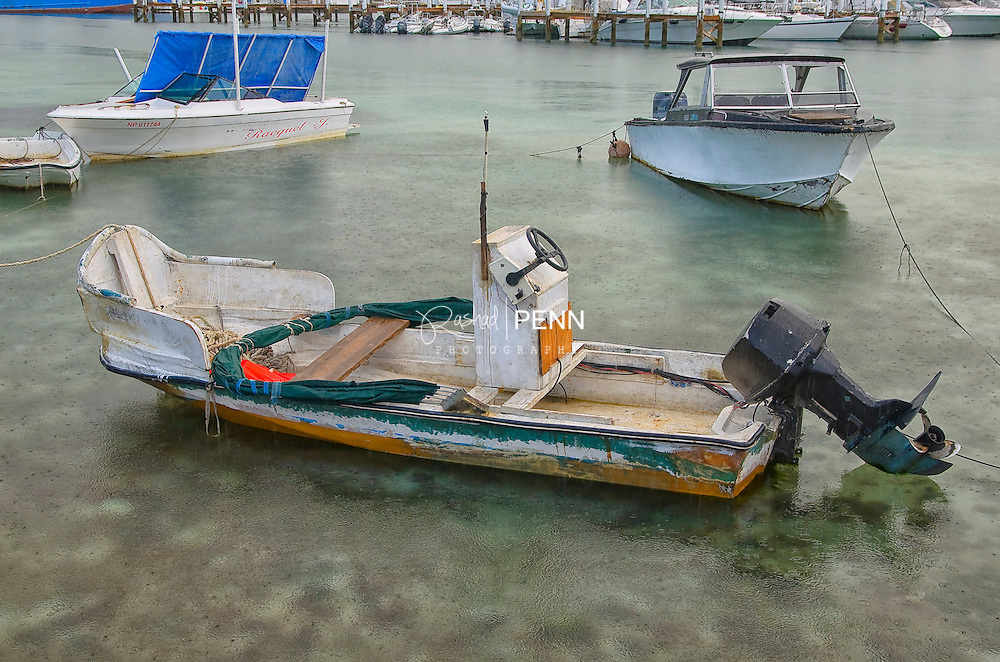 Local fishermen boats in the harbour of potters cay dock on a rainy morning in the Bahamas