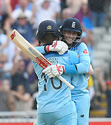 England win - Eoin Morgan of England and Joe Root of England hug after chasing down the Australian total to reach the final during the ICC Cricket World Cup 2019 semi final match between Australia and England at Edgbaston, Birmingham, United Kingdom on 11 July 2019.
