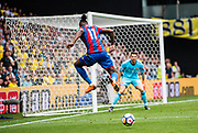 Wilfried Zaha (11) of Crystal Palace, Watford (30) Orestis Karnezis  during the Premier League match between Watford and Crystal Palace at Vicarage Road, Watford, England on 21 April 2018. Picture by Sebastian Frej.