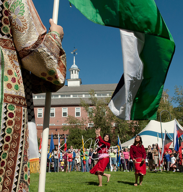 Fifty one flags representing fifty one countries encircled Champa and Anjana Dulal as they perform a traditional Nepali dance in Rotary Park Saturday during the annual Multicultural Market Day festivities.  (Karen Bobotas/for the Laconia Daily Sun)