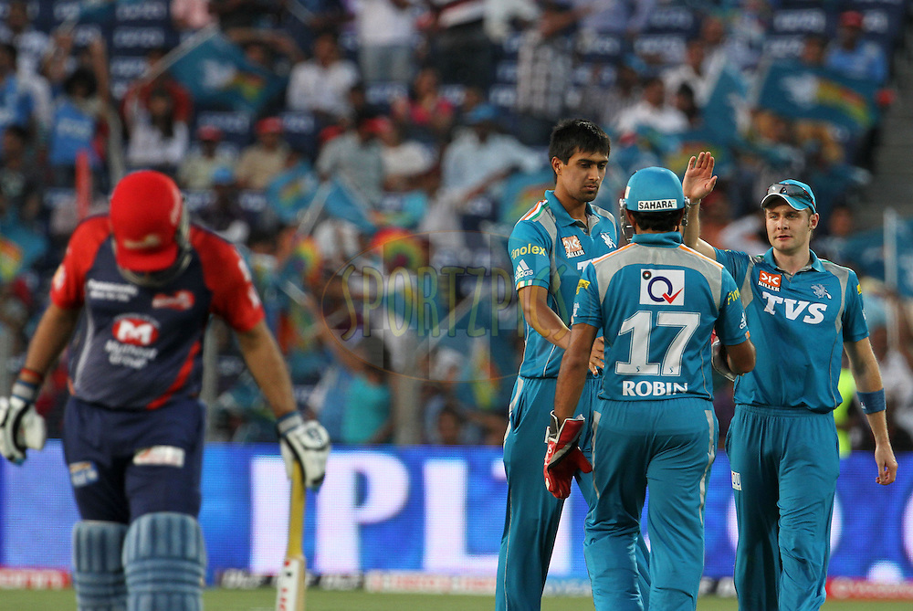Pune Warriors players celebrates after a wicket during match 31 of the Indian Premier League ( IPL) 2012  between The Pune Warriors India and the Delhi Daredevils held at the Subrata Roy Sahara Stadium, Pune on the 24th April 2012..Photo by Vipin Pawar/IPL/SPORTZPICS