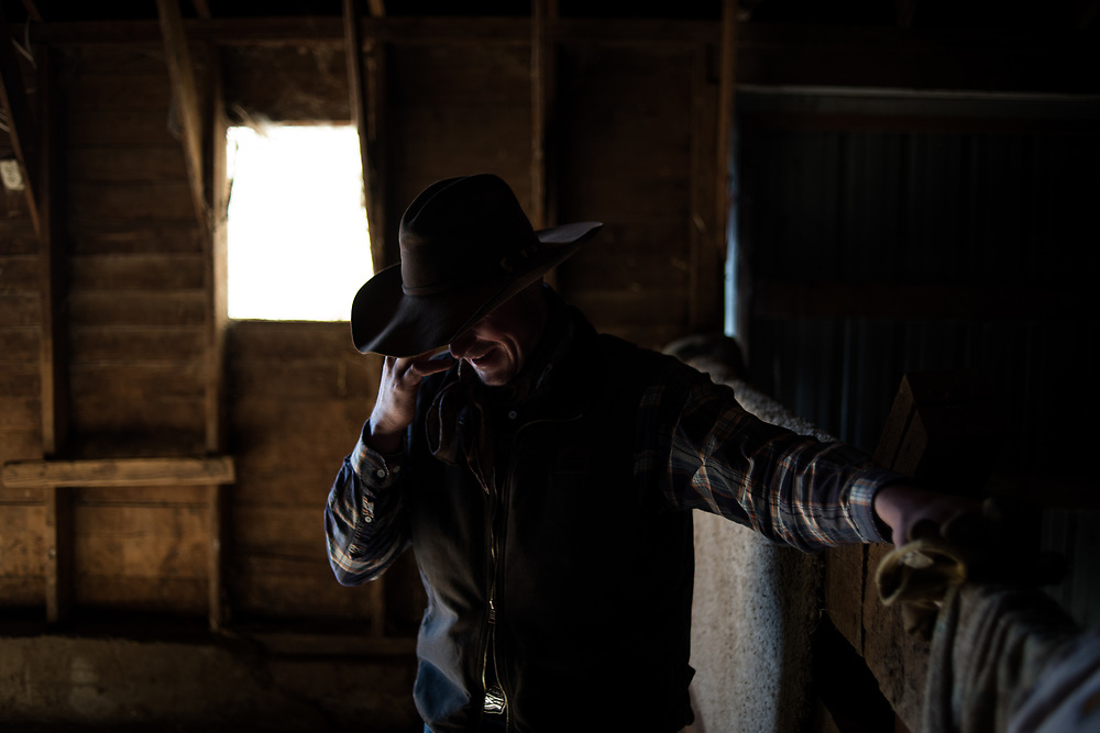 Riley Cihak fesses up to a mistake made while working as a hand on a ranch in the old abandoned town of in Chance, SD on October 5, 2017. Without a ranch in the family or the sizable savings required to buy a ranch, many locals with the skills to work with cattle work on a freelance basis for ranch owners, though some like Cihak have earned their way to permanent jobs for other ranchers.
