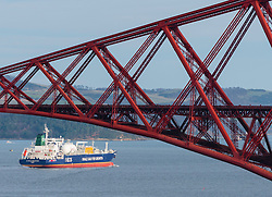 An LNG ship operated by INEOS leaves Grangemouth refinery on the River Forth and passes below the famous Forth Bridge. The ship is designed to transport shale gas from the USA to Grangemouth in Scotland.