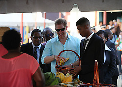 Prince Harry attends a St Lucian street festival in Soufriere on the island of St Lucia during the second leg of his Caribbean tour.