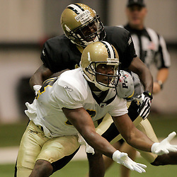 08 August 2009: Receiver D'Juan Woods (84) and cornerback Danny Gorrer (38) fight for position on a play during the New Orleans Saints annual training camp Black and Gold scrimmage held at the team's indoor practice facility in Metairie, Louisiana.