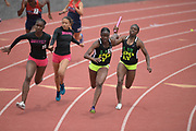 Zanae Woods takes the handoff from Queen Okoh on the anchor leg of the Long Beach Poly girls 4 x 100m relay that won in 46.70 during the 2019 CIF Southern Section Masters Meet in Torrance, Calif., Saturday, May 18, 2019.
