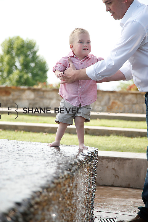 5/28/15 6:10:19 PM -- Miracle Miles and his family pose for portraits and play at the QuikTrip park for the 2015 Saint Francis Health System advertising campaign. <br /> <br /> Photo by Shane Bevel