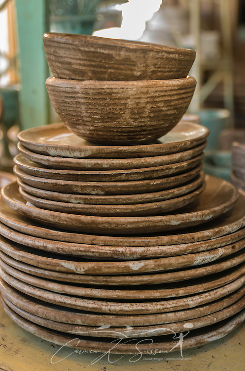 Mississippi Gift Company sells a wide variety of Peter's Pottery pieces, including these plates, saucers, and bowls. (Photo by Carmen K. Sisson)