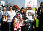 Herlinda Zambrano, the aunt of Antonio Zambrano-Montes, comforts Ginelle Magana, 5, Zambrano-Montes' niece, both of Pasco, as they march during a rally on Saturday, February 14, 2015.