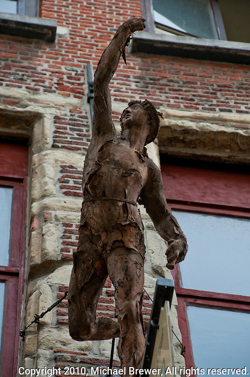 Rusting statue on a bullding in Antwerp, Belgium