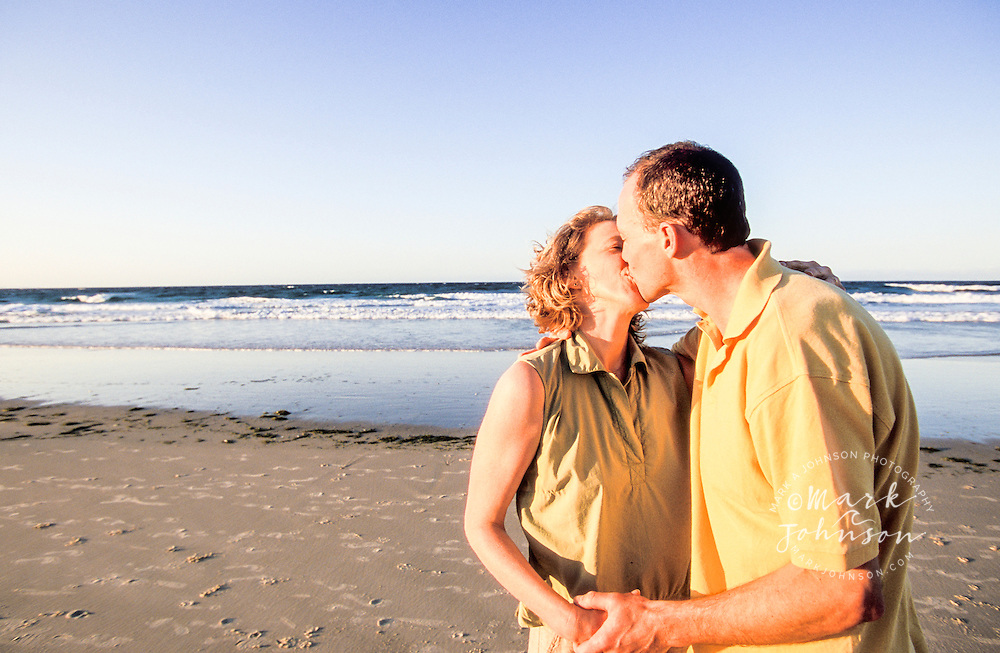 Couple kissing on beach, Queensland, N. Stradbroke Island, Australia