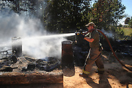 Lafayette County fireman Jonathan Hollis fights a fire on County Road 121 near Abbeville, Miss. on Wednesday, September 29, 2010.