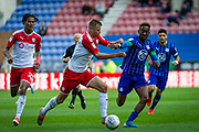 Barnsley Mads Andersen and Wigan Jamal Lowe during the EFL Sky Bet Championship match between Wigan Athletic and Barnsley at the DW Stadium, Wigan, England on 31 August 2019.