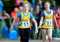 20 Aug 2016: Hollie Walsh, right, Roscommon, after handing the baton to Anna O'Donovan who runs the final leg of Girls U14 4x100 Relay.   2016 Community Games National Festival 2016.  Athlone Institute of Technology, Athlone, Co. Westmeath. Picture: Caroline Quinn