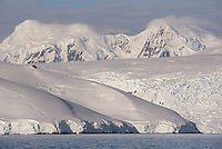Mountains and glaciers near Cuverville Island in Ererra Channel, Antarctica.