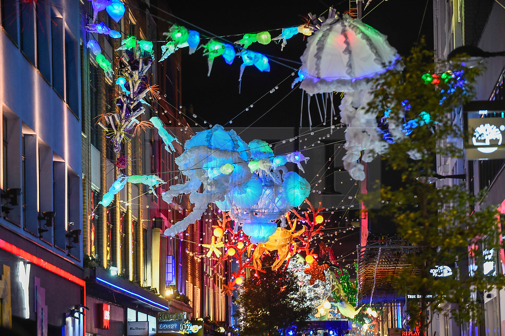 © Licensed to London News Pictures. 07/11/2019. LONDON, UK.  The Christmas lights in Carnaby Street have been switched on tonight.  Running the length of Carnaby Street, the lights recreate underwater scenes overhead, with sections representing different areas of the ocean in need of conservation.  The sustainable light installation has been designed in collaboration with ocean conservation charity, Project 0, who also worked with Carnaby and artist James Chuter on a colourful sealife mural in the area.  1,500 recycled bottles have been used to create the display, along with repurposed fishing nets.  .  Photo credit: Stephen Chung/LNP