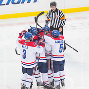 UMass Lowell players in action during the Frozen Fenway game between The Northeastern Huskies and The UMass Lowell Riverhawks at Fenway Park on January 11, 2014 in Boston, Massachusetts.