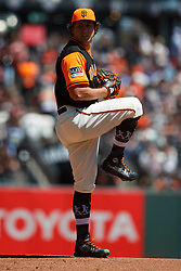 SAN FRANCISCO, CA - AUGUST 26: Derek Holland #45 of the San Francisco Giants pitches against the Texas Rangers during the first inning at AT&T Park on August 26, 2018 in San Francisco, California. The San Francisco Giants defeated the Texas Rangers 3-1. All players across MLB will wear nicknames on their backs as well as colorful, non-traditional uniforms featuring alternate designs inspired by youth-league uniforms during Players Weekend. (Photo by Jason O. Watson/Getty Images) *** Local Caption *** Derek Holland