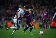 Leo Messi drives the ball pursued by Galvez of Rayo Vallecano (left) during the Spanish league football match of 'La Liga'  FC BARCELONA against RAYO VALLECANO at Camp Nou Stadium of Barcelona on March 9,2019
