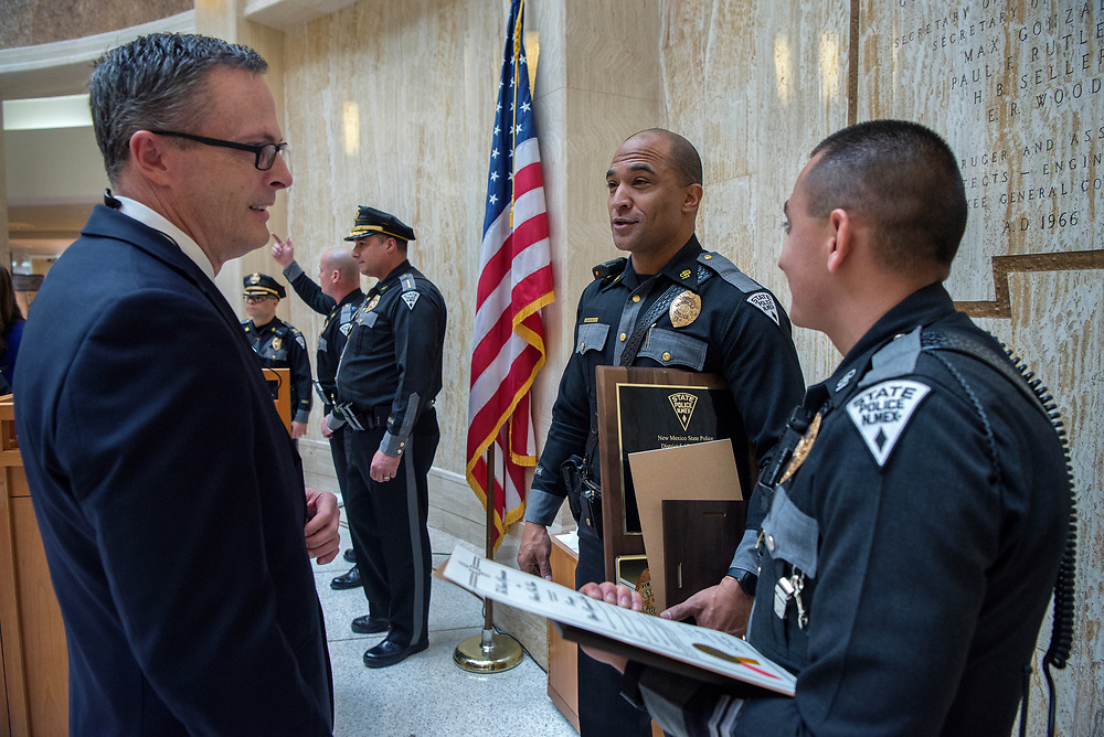 em020518d/a/Department of Public Safety Sec. Scott Weaver, left, congratulates State Police Officers Toby LaFave and Raymundo Lujan, from Albuquerque, in the Rotunda of the State Capitol in Santa Fe Monday, February 5, 2018. Both Lujan and LaFave received awards for leading the state in DWI arrest last year. LaFave received the 1047 award for most DWI's in the State. He arrested 136 DWI's durng 2017.   (Eddie Moore/Albuquerque Journal)