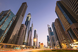 Evening view of skyscrapers along Sheikh Zayed Road in Dubai United Arab Emirates.