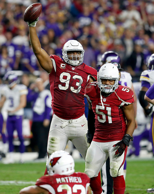 Arizona Cardinals defensive end Calais Campbell (93) holds up the football after a fumble recovery for the win against the Minnesota Vikings during the second half of an NFL football game, Thursday, Dec. 10, 2015, in Glendale, Ariz. The Cardinals won 23-20. (AP Photo/Rick Scuteri)