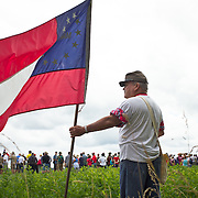 Jon Garner, of Garrett County, Maryland, held his Maryland Confederate flag, while waiting to participate in, for the 19th year in a row, the Pickett's Charge Commemorative March, during the Sesquicentennial Anniversary of the Battle of Gettysburg, Pennsylvania on Wednesday, July 3, 2013.  The march was an opportunity to follow in the footsteps of Confederate soldiers by walking with living historians and park rangers along the path of the famously ill-fated Pickett's Charge, which brought to a close The Battle of Gettysburg when the Union Army repelled their advance. The Battle of Gettysburg lasted from July 1-3, 1863 resulting in over 50,000 soldiers killed, wounded or missing.  John Boal Photography