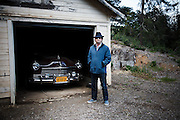 "Napa Valley, April 5 2012 - Roman Coppola posing in front of the 49 Hudson car used in the movie ""On the Road"" by Walter Salles."