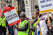PCS picket line outside the House of Commons. Hundreds of thousands of public sector workers are taking part in a 24-hour UK-wide strike in a dispute with the government over pension changes.