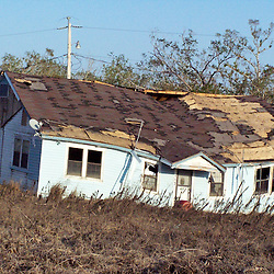 Scenes of devastation left in the aftermath of Hurricane Katrina that flooded the small city of Buras, Louisiana in Plaquemines Parish on August 29, 2005. A house washed off it's foundation sits in a field...(Mandatory Credit: Photo by Derick E. Hingle)
