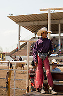 Crow Fair Rodeo, Crow Indian Reservation, Montana, young Steer Rider