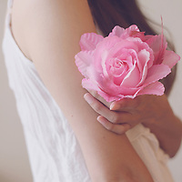 Girl holding a pink rose