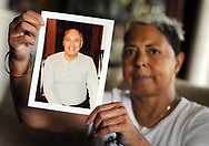 Miriam Rodriguez, of Bethlehem, Pennsylvania holds a photograph of her brother Frank Rodriguez in her living room Tuesday, September 26, 2017 in Bethlehem, Pennsylvania. Frank Rodriguez -- who was in state prison for violating parole (smoking marijuana) on a felony (theft of a $1 lemonade) -- was on death vigil in prison for 10 weeks before finally being granted compassionate release. He died a day and a half later. (WILLIAM THOMAS CAIN / For The Philadelphia Inquirer)