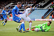 Peterborough defender Jason Naismith (2) just misses out on this through ball that was collected by Burton Albion goalkeeper Bradley Collins (40) the EFL Sky Bet League 1 match between Peterborough United and Burton Albion at London Road, Peterborough, England on 4 May 2019.