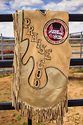 14 JULY 2012 - OAK SPRINGS, AZ:  A cowboy's chaps on a fence during a bull riding class. The bull riding class was offered by the Crooked Horn Cattle Co. in the community of Oak Springs on the Navajo Nation, about 15 miles south of Window Rock, AZ. Eleven cowboys signed up for bull riding classes and one signed up for bull fighting classes. The bull riding class started with lessons on a mechanical bucking machine before the cowboys rode bulls.    PHOTO BY JACK KURTZ
