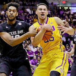Feb 13, 2016; Baton Rouge, LA, USA; Texas A&M Aggies center Tonny Trocha-Morelos (10) fouls LSU Tigers forward Ben Simmons (25) during the first half of a game at the Pete Maravich Assembly Center. Mandatory Credit: Derick E. Hingle-USA TODAY Sports